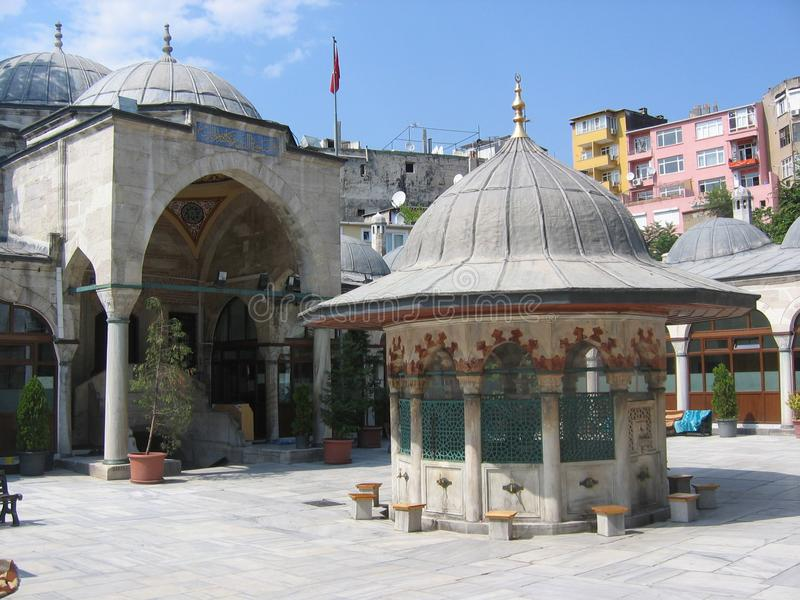 Courtyard of a mosque to Istanbul with a fountain to the center. Turkey royalty free stock photo