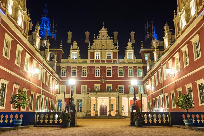 The courtyard of the New Castle in the park Muskauer at night. In Germany stock photos