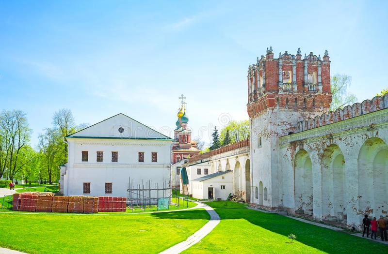 The courtyard of Novodevichy Convent. Novodevichy Convent is a popular place among tourists and locals, its a very confortable place for leisure walking in calm stock image