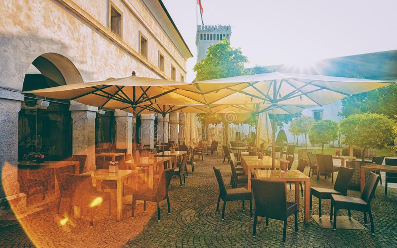 Courtyard at Old castle in historical center Ljubljana Slovenia. Sidewalk cafe at Old castle on Castle hill in the historical center of Ljubljana, Slovenia royalty free stock images