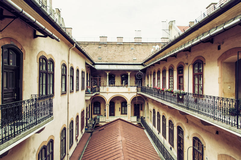 Courtyard of old stylish building in historic centre of Budapest. Hungary. Architectural theme. Cultural heritage. Possibility of accommodation. Old house stock photos