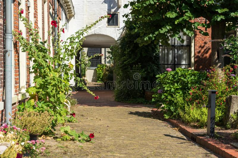 Courtyard Pepergasthuis. Detail of old public courtyard Pepergasthuis in the Dutch city of Groningen on a summers day royalty free stock photos