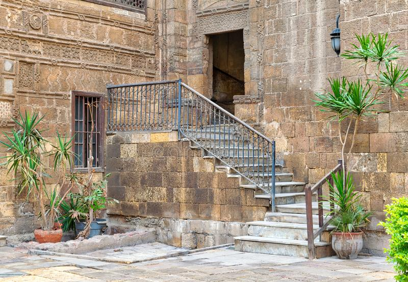 Courtyard of Prince Tax palace with staircase and entrance leading to the first floor. Located in Old Cairo, Egypt royalty free stock photography