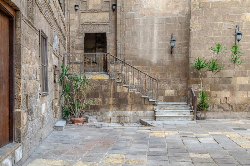 Courtyard of Prince Tax palace with staircase and entrance leading to the first floor, Old Cairo, Egypt. Courtyard of Prince Tax palace with staircase and stock photos
