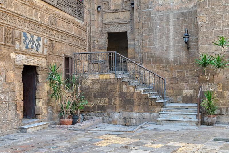 Courtyard of Prince Taz palace with staircase and entrance, Old Cairo, Egypt. Courtyard of Prince Taz palace with staircase and entrance leading to the first stock photos