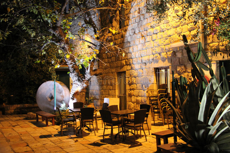 Courtyard of small modern theater near the old railway station. JERUSALEM, ISRAEL - DECEMBER 10, 2013: Courtyard of small modern theater near the old railway royalty free stock photo