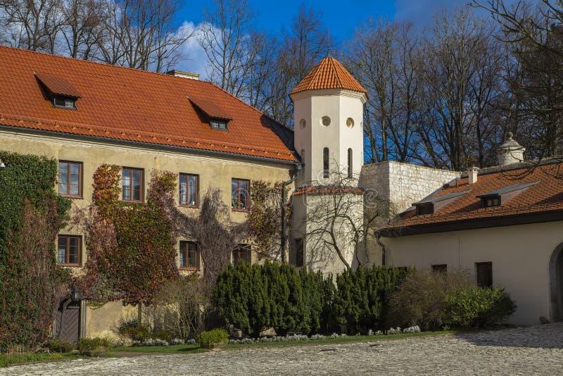 The courtyard and the towers of Peskova skala. The courtyard and one of the towers of the castle `Peskova skala` near the city of Krakow. Poland royalty free stock images