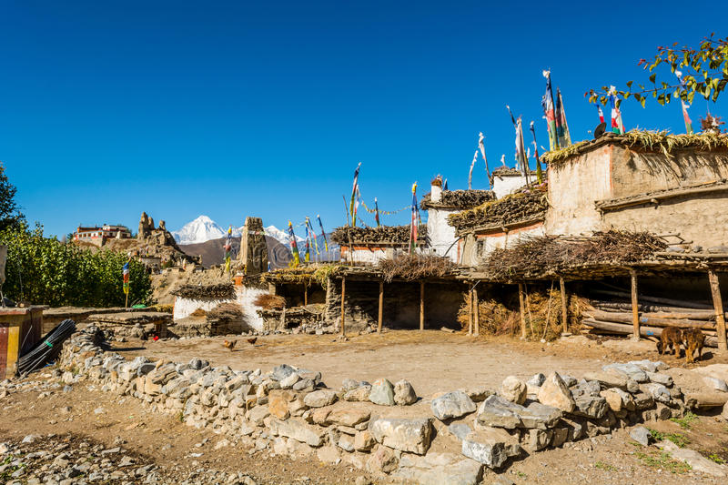 Courtyard in traditional stone build village of Jhong. stock image