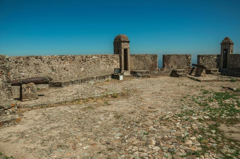 Courtyard with walls and rusty cannon at the Marvao Castle stock photography