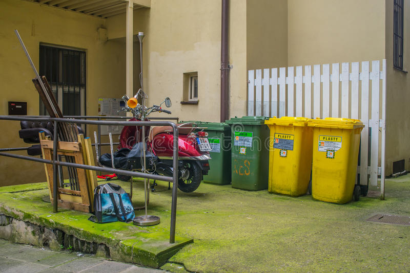 Courtyard with waste segregation and a scooter parked stock photography