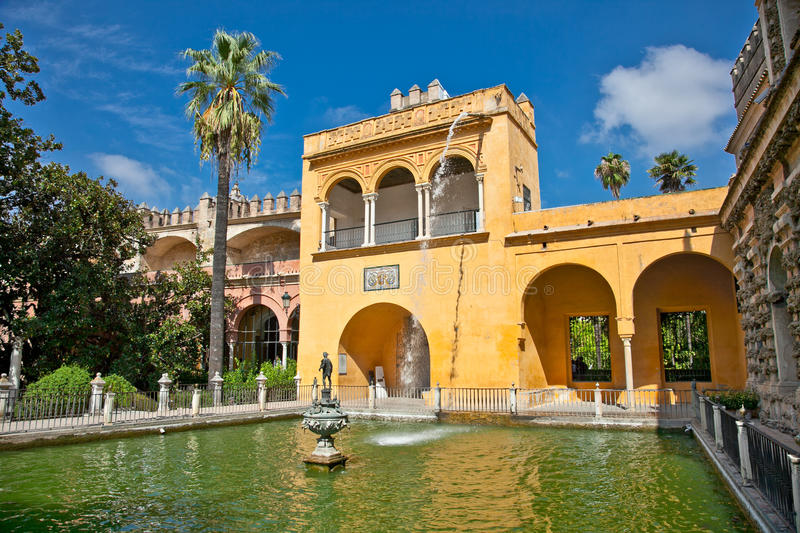 Courtyard with water pool of Alcazar,, Seville, Spain royalty free stock photos