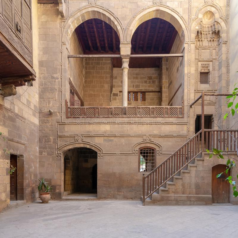 Courtyard of Zeinab Khatoun historic house, located near to Al-Azhar Mosque, Old Cairo, Egypt. Facade of Zeinab Khatoun historic house, located near to Al-Azhar stock image