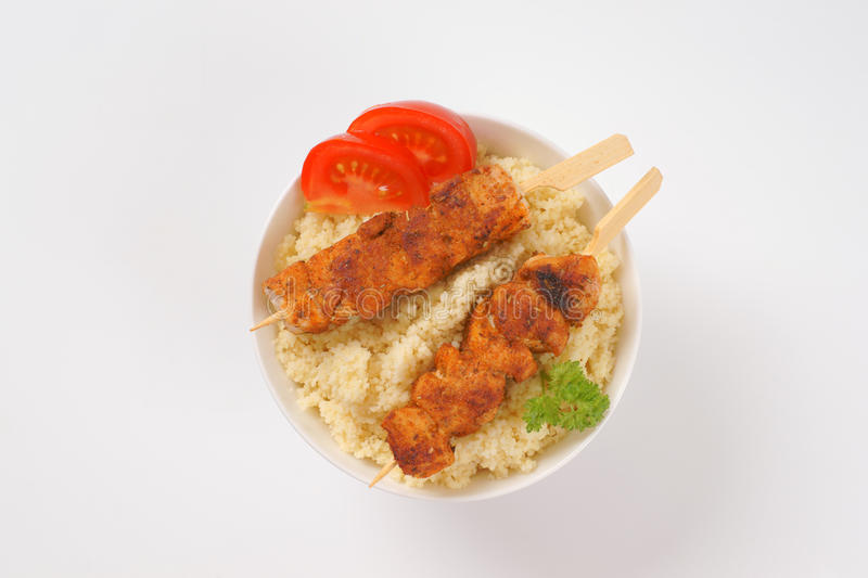 Couscous and chicken skewer royalty free stock photos