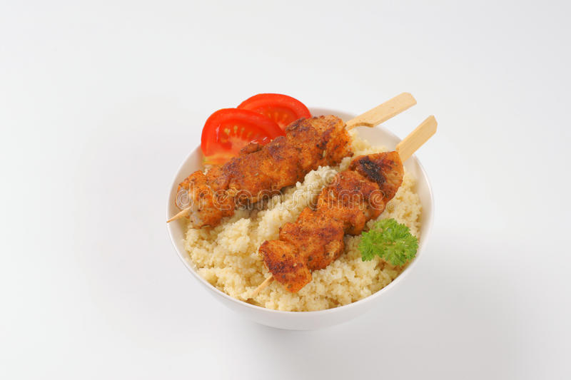 Couscous and chicken skewer stock photos
