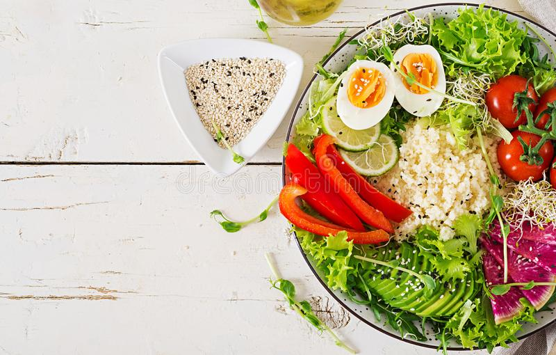 Couscous, egg and vegetables bowl. Healthy, diet, vegetarian food concept. royalty free stock photo