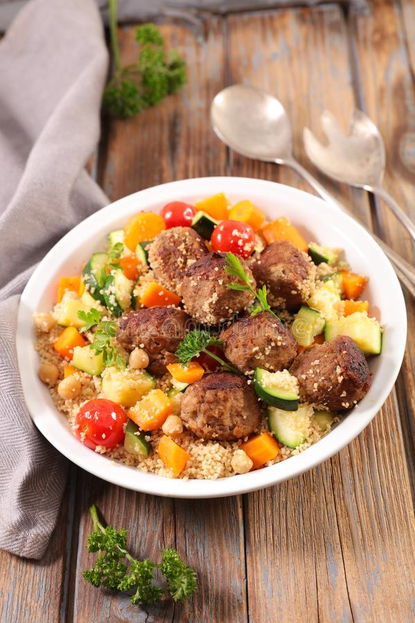 Couscous with meatball stock images