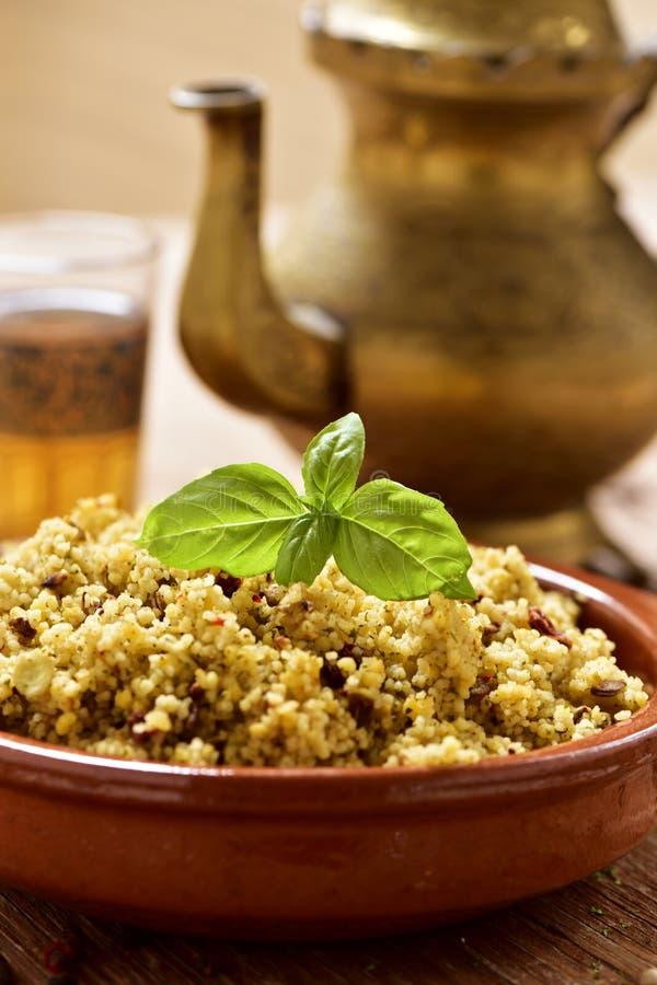 Couscous med grönsaker och te arkivfoton