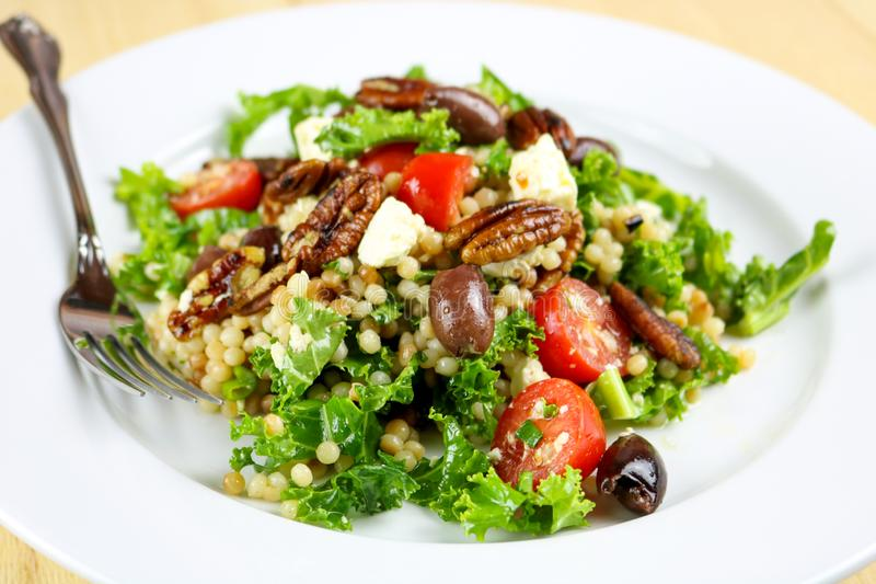 Couscous Salad with Kale, Pecans & Feta Cheese royalty free stock image