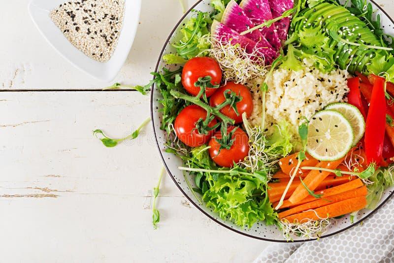 Trend food. Healthy, diet, vegetarian food concept. Couscous and vegetables bowl.  Trend food. Healthy, diet, vegetarian food concept on a light background stock images
