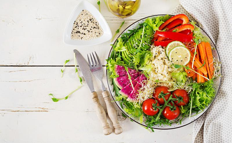 Couscous and vegetables bowl. Trend food. Healthy, diet, vegetarian food concept on a light background . Vegan buddha bowl. Top view stock photos