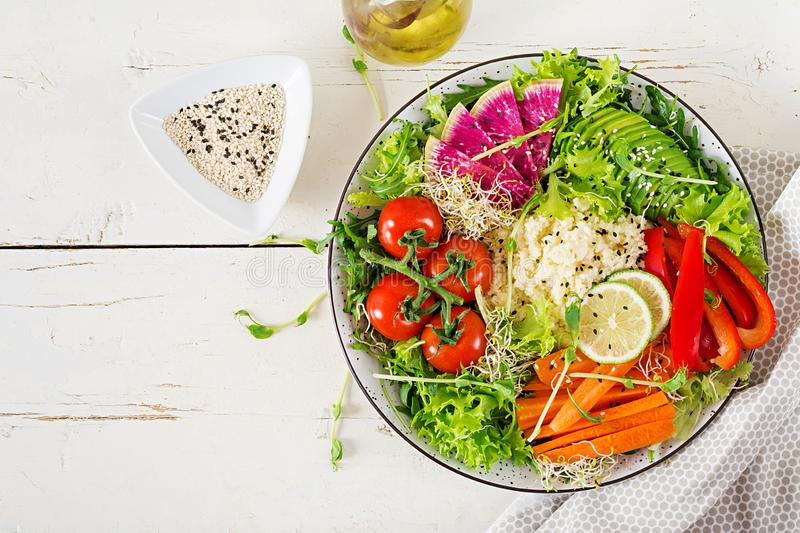 Couscous and vegetables bowl.  Trend food. Healthy, diet, vegetarian food concept on a light background . Vegan buddha bowl. Top view royalty free stock images