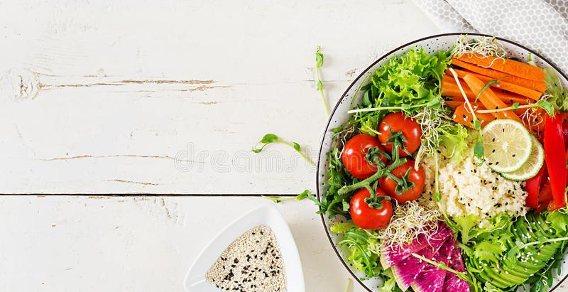Couscous and vegetables bowl. Trend food. Couscous and vegetables bowl.  Trend food. Healthy, diet, vegetarian food concept on a light background . Vegan buddha stock image