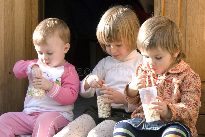 Download Cousins Eating Popcorn Stock Photo - Image: 6144260
