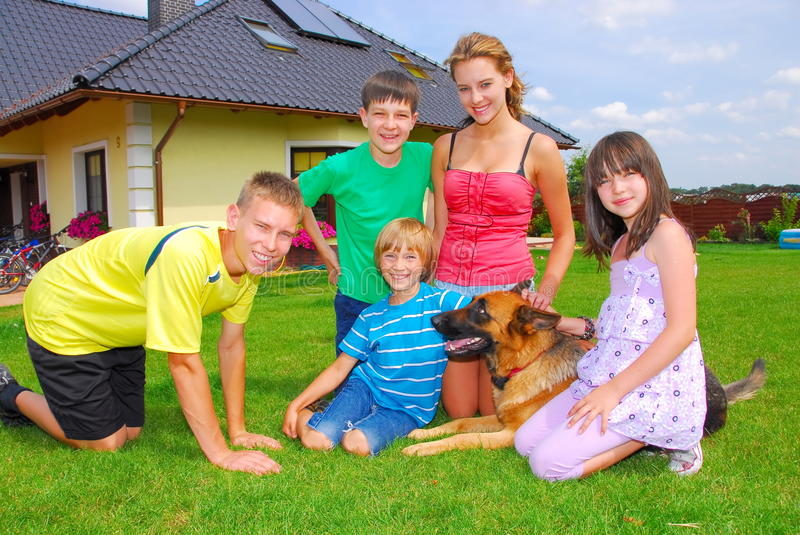 Cousins with pet stock image