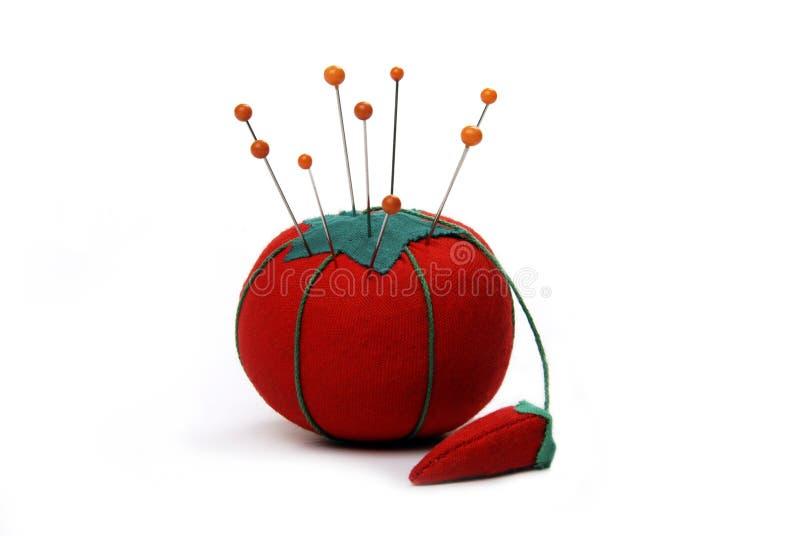 Coussin de broche de tomate images libres de droits