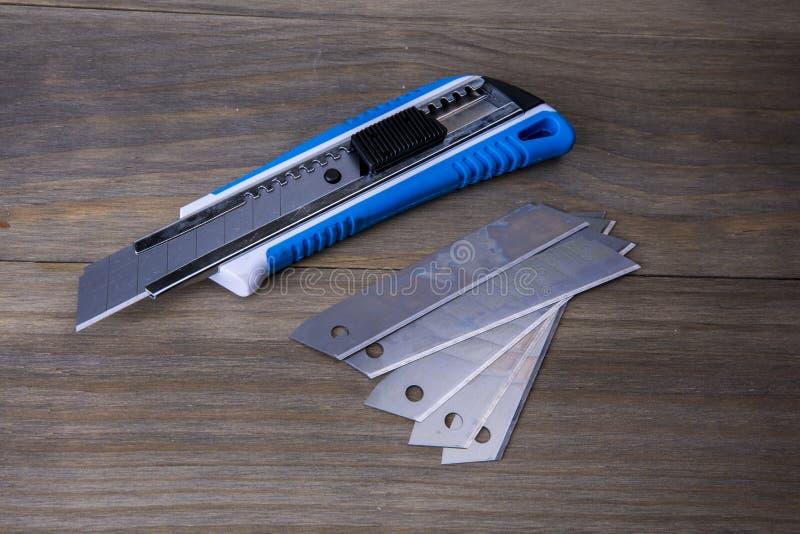Couteau de coupeur et lames disponibles photographie stock