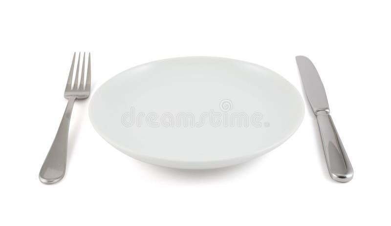 Couteau de Tableau, fourchette et plat en céramique d'isolement images libres de droits