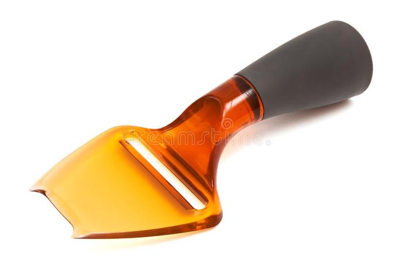 Couteau en plastique de fromage photographie stock libre de droits