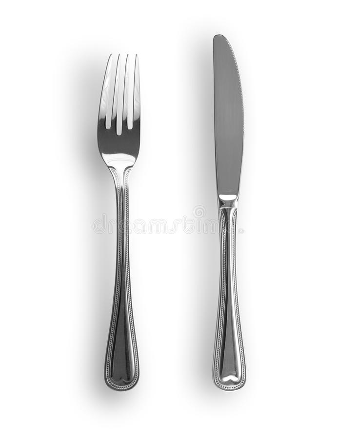 Couteau et fourchette d'isolement photographie stock