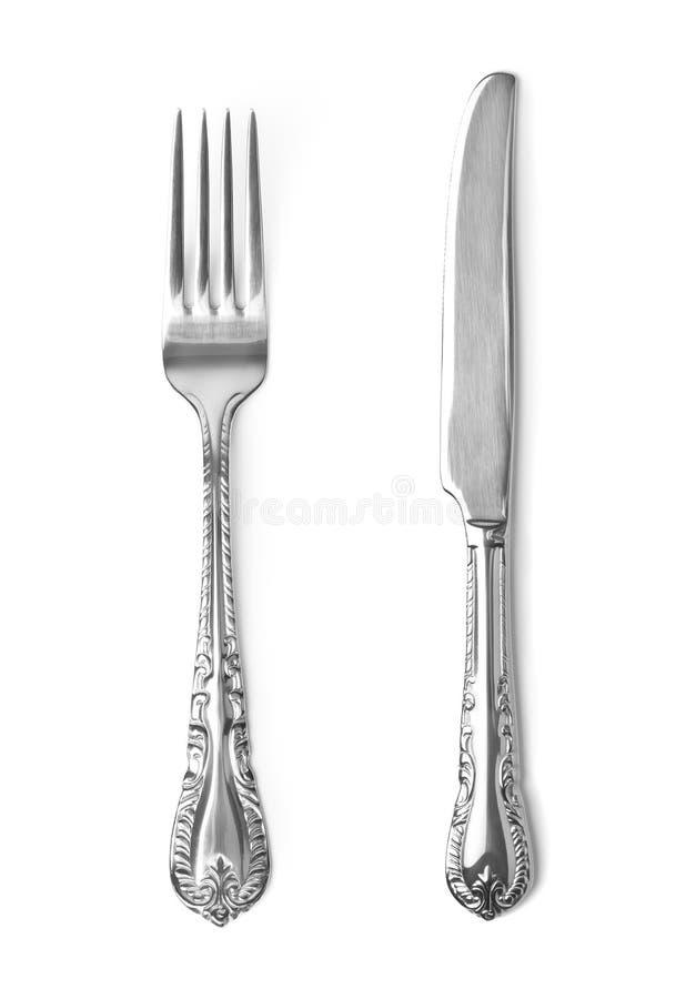 Couteau et fourchette de vintage sur le fond blanc photos stock