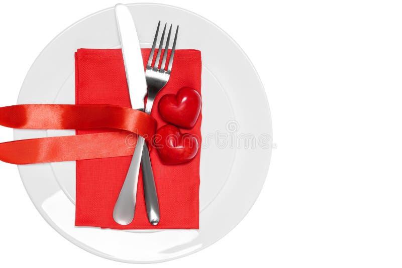 Couteau, fourchette et coeurs du plat Concept de jour du ` s de Valentine photos libres de droits
