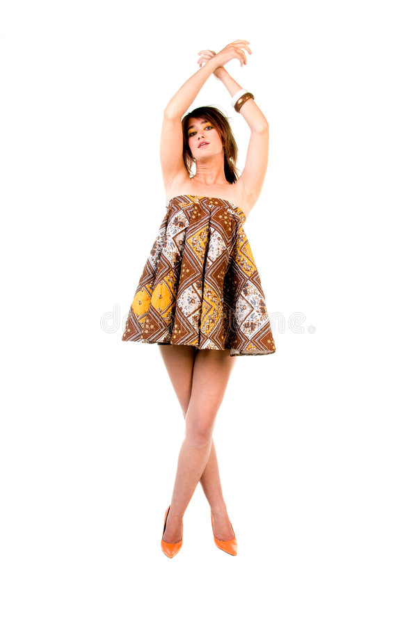 Couture Ballet. Beautiful young fashion model in a couture mini dress, orange high heel shoes dancing ballet stock photography