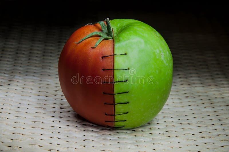 Couture de tomate d'Apple photographie stock