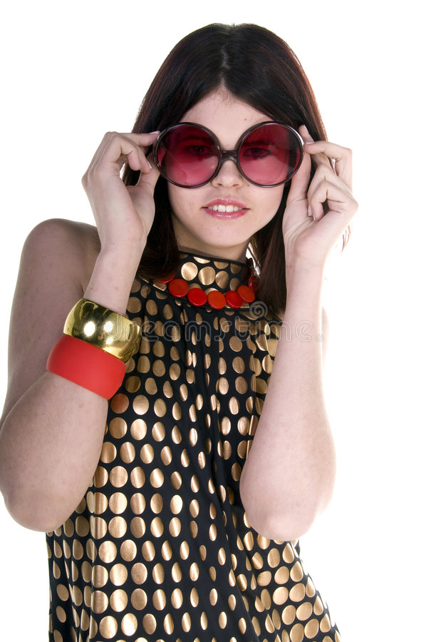Couture Fashion Model. A beautiful and hip young woman in a black and gold Couture dress wearing big retro sunglasses royalty free stock photography