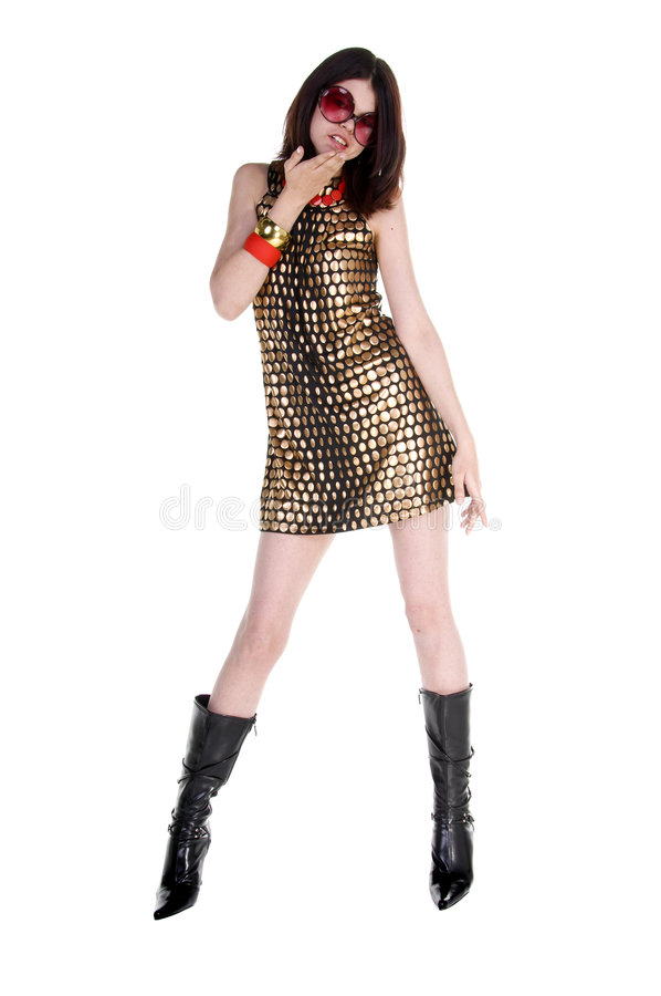 Couture Fashion Model. A beautiful and hip young woman in a black and gold Couture dress and big retro sunglasses stock images