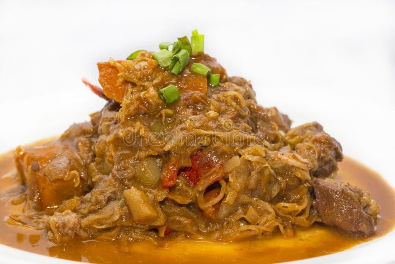 Couve Stewed com carne foto de stock