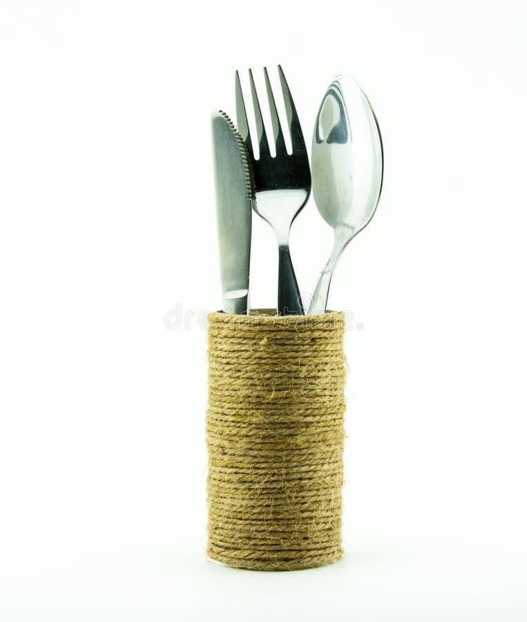 Couverts et couteaux dans des accessoires ronds de cuisine de boîtes pour la nourriture image libre de droits