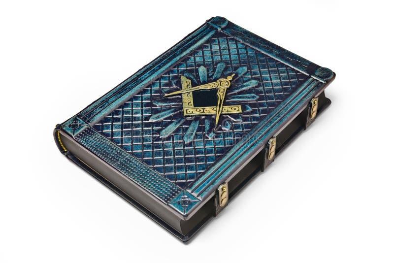 Couverture de livre en cuir bleu-foncé âgée avec le symbole de place et de boussole sur la couverture images libres de droits
