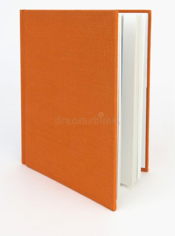 Couverture orange de tissu de livre images stock