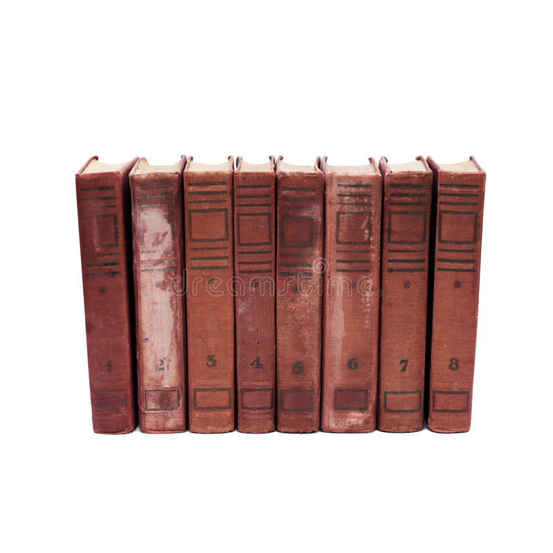 Couvertures de livre antiques sur le fond blanc huit volumes de livres antiques avec des nombres de 1 à 8 Collection rare images libres de droits
