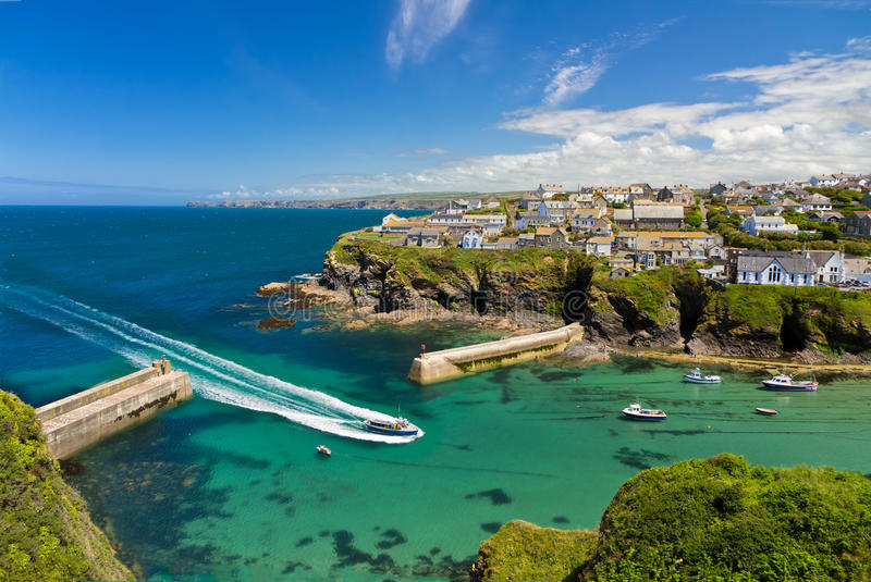 Cove and harbour of Port Isaac with ship, Cornwall. Cove and harbour of Port Isaac with arriving ship, Cornwall, England stock image