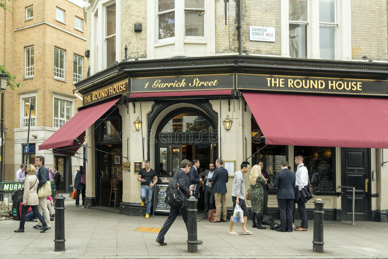 Covent Garden. LONDON, UNITED KINGDOM - JUNE 5, 2014: Customers outside The Round House a popular pub near Covent Garden, London royalty free stock photography