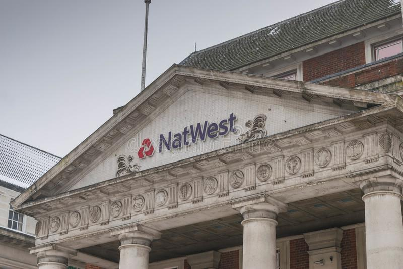 COVENTRY, ENGLAND, UK - 3rd March 2018: NastWest bank branch in Coventry city centre in a cloudy snowing morning. The royalty free stock photos