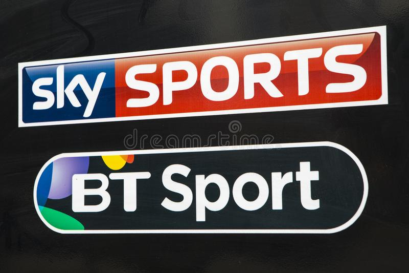 Sky Sports and BT Sport Logos. COVENTRY, UK - JULY 26TH 2018: A close-up of the logos for Sky Sports and BT Sport, pictured on a public house sign, on 26th July royalty free stock photography