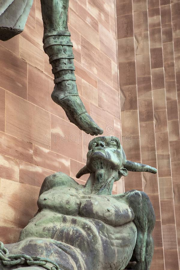St. Michaels Victory over the Devil at Coventry Cathedral stock photography