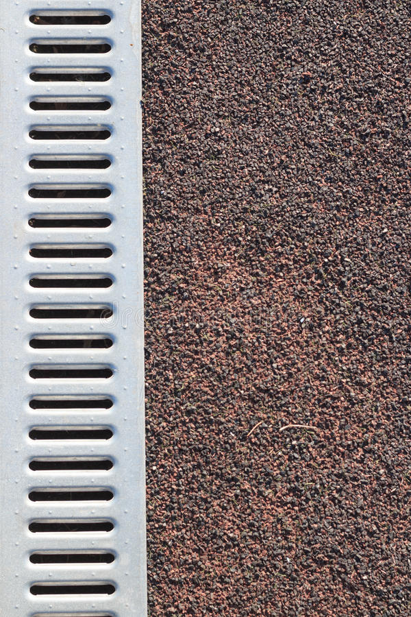 Coverage stadium with metall water drain texture. Background stock photos